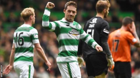 Kris Commons celebrates making it 3-0 to Celtic with a thumping penalty