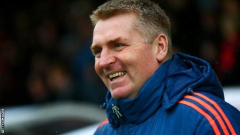 Brentford boss Dean Smith looks on from the dugout