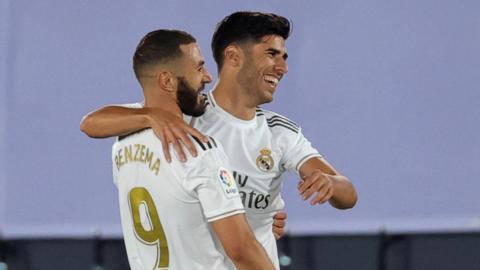 Asensio celebrates with Benzema
