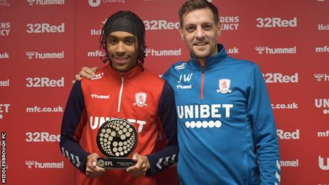 Middlesbrough defender Djed Spence with the award and head coach Jonathan Woodgate