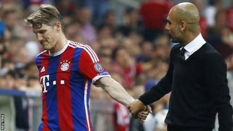Bayern Munich midfielder Bastian Schweinsteiger (left) and manager Pep Guardiola