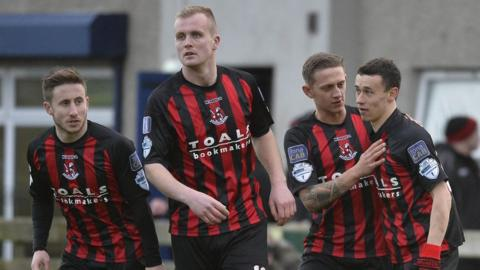 Paul Heatley opened the scoring from the penalty spot as Crusaders saw off Warrenpoint Town 3-1