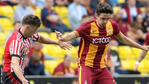 Alex Jones (right) in action for Bradford City