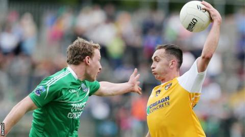 Fermanagh's Aiden Breen attempts to close down Antrim forward Brian Neeson