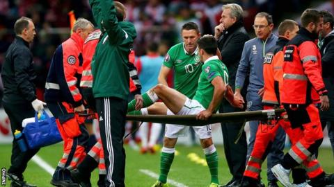 Southampton striker Shane Long is carried off during the Republic of Ireland's 2-1 defeat by Poland