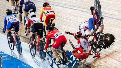 Britain's Laura Kenny (far right) crashes during the tempo race in the women's omnium at the Track World Cup in Milton, Canada