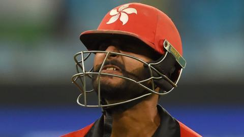 Hong Kong captain Anshy Rath grimaces as he walks off after being dismissed against India