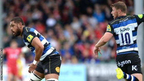 Taulupe Faletau and Rhys Priestland in action for Bath against Scarlets