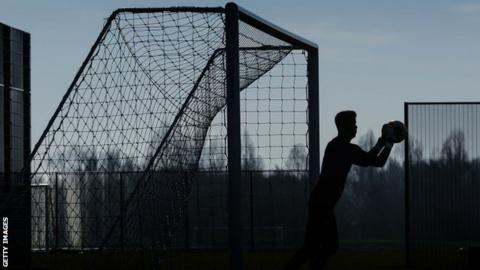 Silhouette image of a goalkeeper