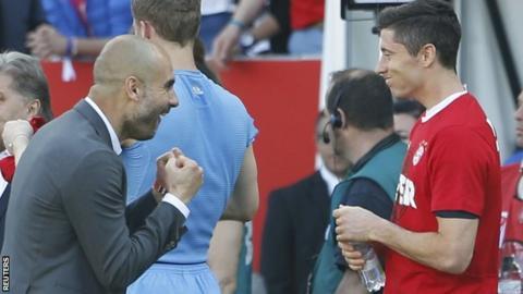 Bayern Munich boss Pep Guardiola (left) celebrates with Robert Lewandowski after the final whistle