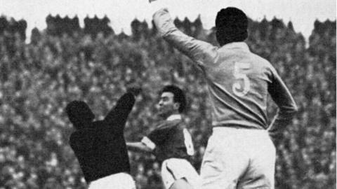 Wales' Ron Hewitt in action against Israel at Ninian Park in 1958.