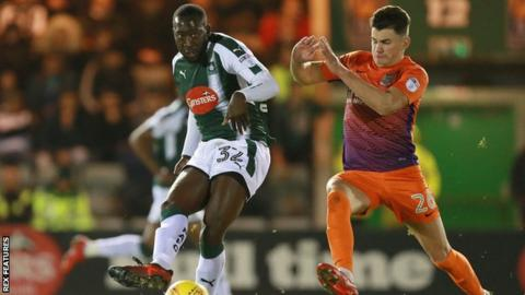 Regan Poole (R) spent last season on loan at Northampton after joining Manchester United from Newport