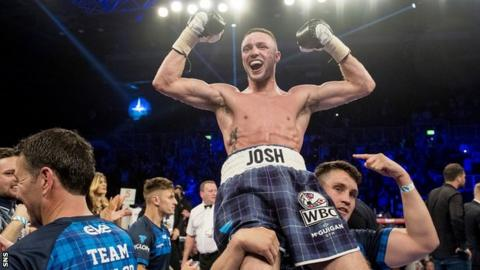 Josh Taylor is held aloft by trainer Shane McGuigan