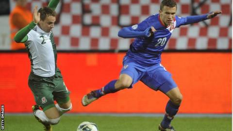 Chris Gunter in action against Croatia's Ivan Perisic