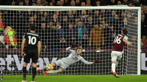 Mark Noble coolly slots his 50th goal for West Ham during the first half at London stadium