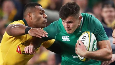 Jacob Stockdale of Ireland is tackled by Samu Kerevi of Australia