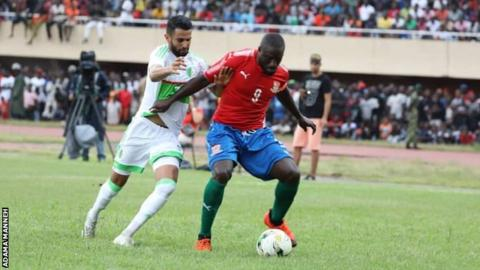 b4a3ee429 Pa Modou Jagne (right) in action for The Gambia against Algeria