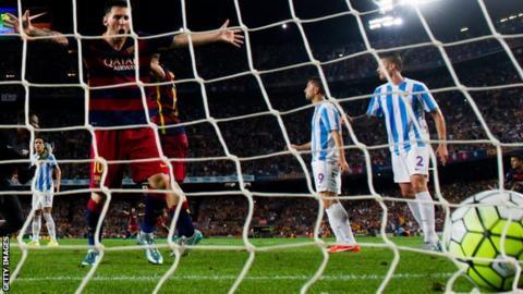 Lionel Messi celebrates Thoams Vermaelen's winning goal