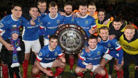 Linfield celebrate their Co Antrim Shield success at the Ballymena Showgrounds in February