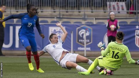 Jodie Taylor (centre) is denied a goal