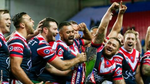 Sydney Roosters players celebrate their 2019 World Club Challenge