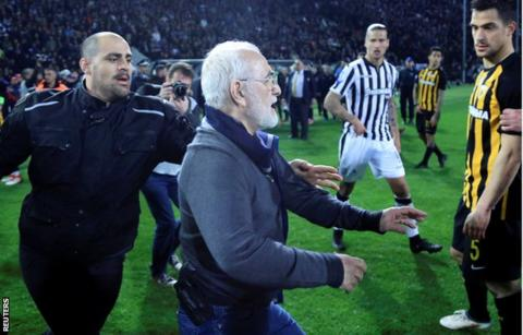 Greek game abandoned as PAOK president invades pitch with a gun