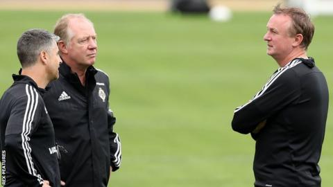 Jimmy Nicholl and former coach Stevie Robinson with Northern Ireland boss Michael O'Neill (left)