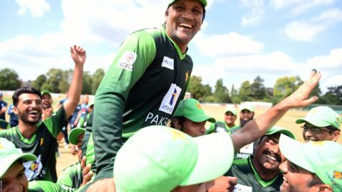 Sher Ali Afridi and the Pakistan players celebrate after winning the Vitality IT20 Physical Disability Tri-Series match against England