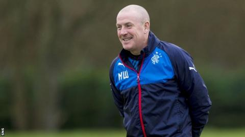 Rangers' boss Mark Warburton all smiles at training