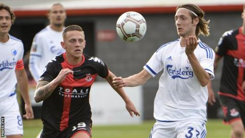 Matthew Snoddy and Rasmus Falk in action during the Champions League qualifier at Seaview