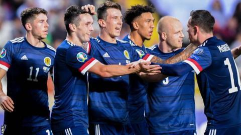 Scotland players celebrate John McGinn's (second left) goal