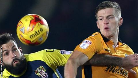 Rhys Healey in action for Newport County