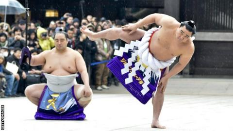 Sumo wrestlers perform a ritual