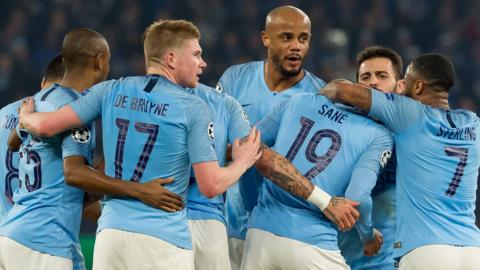 Man City players celebrate a goal against Schalke in the first leg