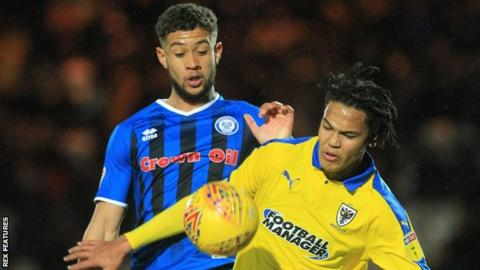 Rekeil Pyke and Toby Sibbick battle for the ball