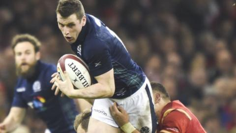 Scotland centre Mark Bennett takes on the Wales defence