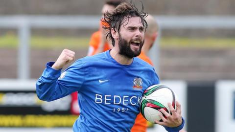 Glenavon player-manager Gary Hamilton celebrates his last-gasp equaliser for the visitors in the 2-2 draw at Carrick