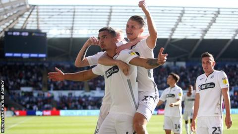 Courtney Baker-Richardson celebrates scoring a goal with George Byers of Swansea City