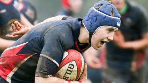 Scott Wilson runs through to score one of Lurgan's tries in their victory over Strabane College