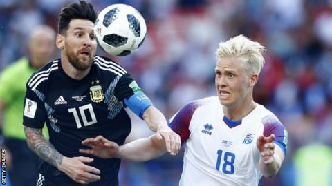 Hordur Magnusson tussles with Lionel Messi