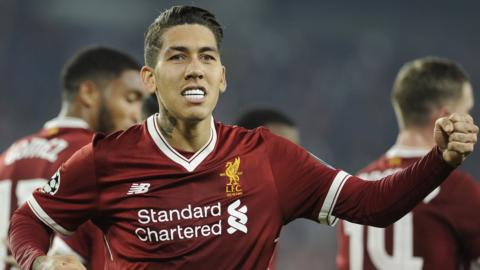 Liverpool forward Roberto Firmino celebrates scoring against Sevilla in the Champions League