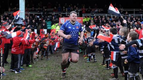 Jordan Williams leads his side out in the WRU National Cup