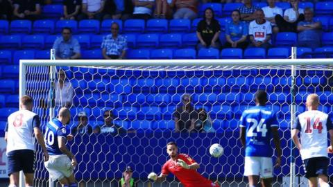 James Norwood of Ipswich Town scores a goal from the penalty spot