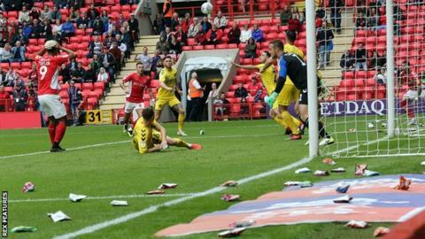 Crisps stop play at Charlton v Fleetwood