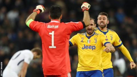 Juventus players celebrate after beating Tottenham