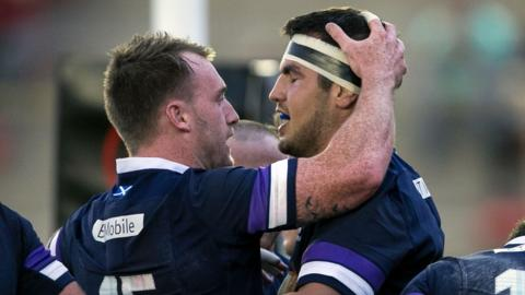 Scotland's Stuart Hogg and Stuart McInally celebrate against Argentina