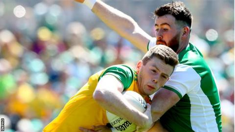Donegal's Eoghan Ban Gallagher and Sean Quigley of Fermanagh battle for possession