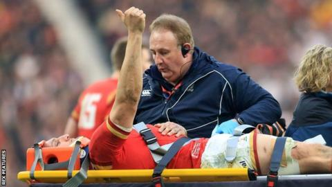 Wales' Sam Warburton put his thumb up to reassure the crowd as he is taken off on a stretcher during the 2016 Six Nations