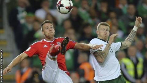 Chris Gunter of Wales and James McClean of Republic of Ireland compete for the ball