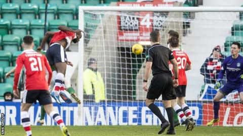 Jean-Yves M'Voto heads Rovers in front at Easter Road